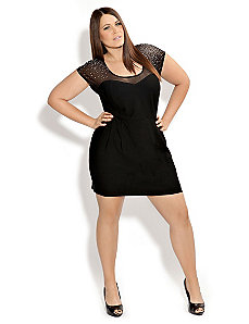 Amazingly thick plus size lady in mini dress with high heels.