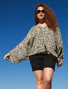 Animal print tassel drama top