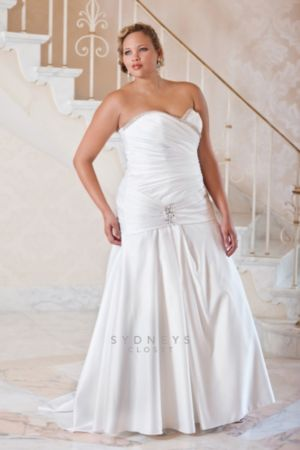 Plus size strapless fit and flare wedding gown in