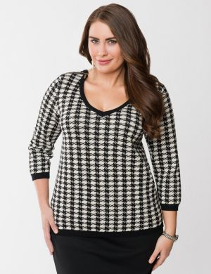 Houndstooth zippered sweater