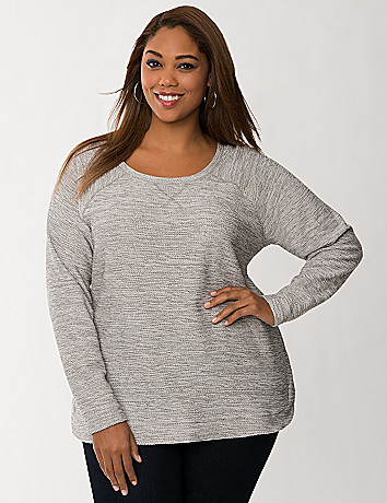 Knit sweatshirt with woven hem