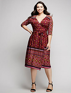 Border-print wrap dress by Kiyonna