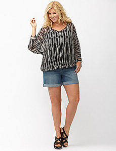 Tribal print tassel drama top