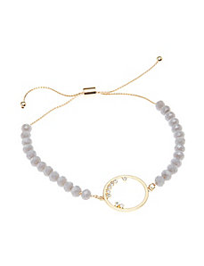 Gray beaded bracelet with goldtone circle